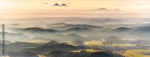 Fototapeta Bezdez twin mountains rising from the mist. Weather temperature inversion, Czech Republic obraz