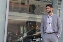 Portrait Confident Car Salesman Looking Away Outside Car Dealership Showroom