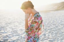 Serene Brunette Woman In Swimsuit Coverup On Sunny Summer Beach