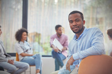 Portrait Confident Man In Group Therapy Session