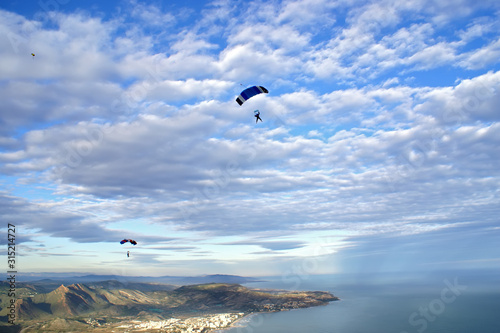 Aerial image of Castellon Spain with skydivers in the background. #315214727