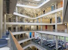 Modern Office Atrium With Balc...