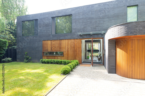 Modern home exterior with brick and wood - 315221963