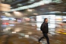 Man Walking On Urban Street At...