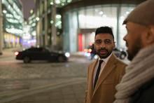 Businessmen Talking On City St...