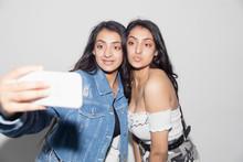 Teenage Twin Girls Taking Self...