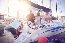 Friends Relaxing On Catamaran ...