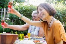 Happy Active Senior Women Toas...
