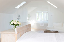 White A-frame Home Showcase Bedroom With En Suite Bathroom