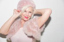 Portrait Smiling, Elegant Senior Woman Wearing Pink Fur