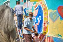 Senior Man Volunteer Painting ...