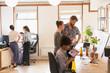 Creative designers brainstorming, planning in office