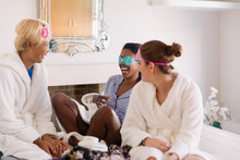 Young Women Friends Wearing Ey...