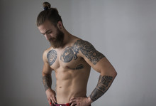 Portrait Bare Chested Man With Tattoos And Beard