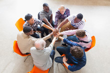 Men Joining Hands In Circle In Prayer Group
