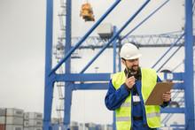 Dock Worker With Walkie-talkie...