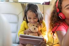 Cute Girl With Teddy Bear Usin...