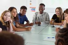 Smiling High School Students Listening In Debate Class