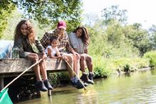 Happy Family Fishing From Sunny Riverside Dock