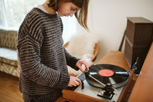 Girl Playing Vinyl Record In Living Room