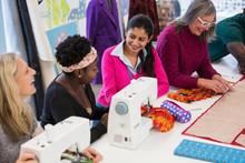 Fashion Designers Using Sewing...