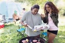 Mother And Daughter Barbecuing...