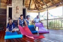 People Unrolling Yoga Mats In ...