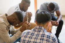 Men Praying With Rosaries In P...