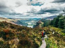 Woman Hiking Along Idyllic Mou...
