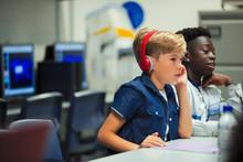 Focused Junior High School Boy With Headphones In Classroom