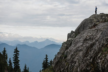 Male Hiker Standing On Rugged ...