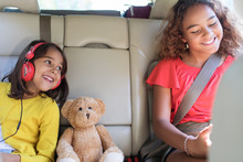 Happy Sisters And Teddy Bear R...