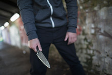 Young Man Holding Knife Weapon...