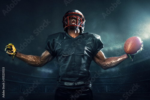 Fototapeta Muscular football player cheering