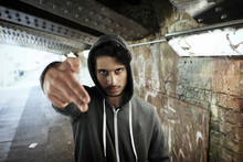 Portrait Tough Young Man Gesturing Finger Gun In Urban Tunnel