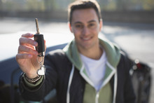 Portrait Smiling, Confident Young Man With New Car Key