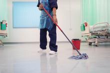 Female Orderly Mopping Hospita...