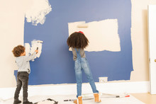 Brother And Sister Painting Wall