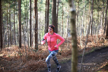 Woman Running On Trail In Autu...