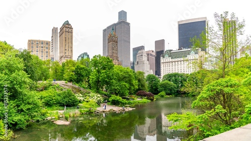New York City Central Park With Cloud And Blue Sky.