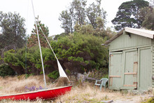 Boat And Old Boat Shed On Beach