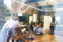 Male Barber Shaving Face Of Customer In Barbershop