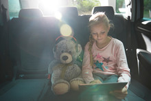 Girl With Teddy Bear Using Dig...
