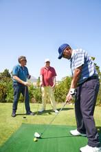 Male Golfer Practicing Swing A...