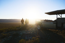 Safari Tour Group And Off-road Vehicle On Hill At Sunrise South Africa