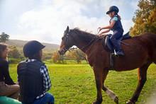 Girl Learning Horseback Riding...