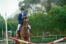 Teenage Girl Equestrian Jumping