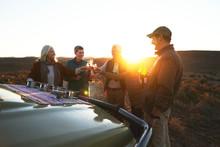 Safari Tour Group Toasting Cha...