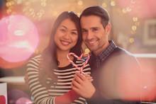Portrait Smiling Couple Holdin...