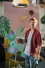 Portrait Male Artist With Lapt...